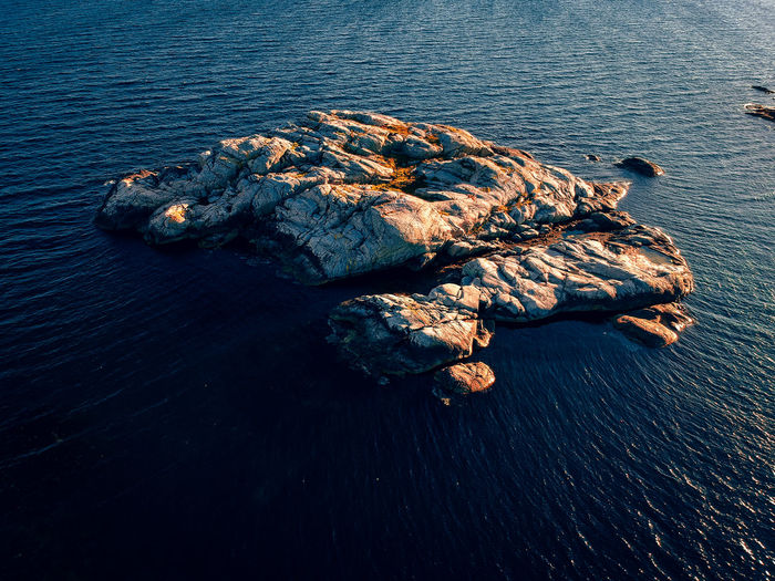 Aerial view of a small island in evening sun.