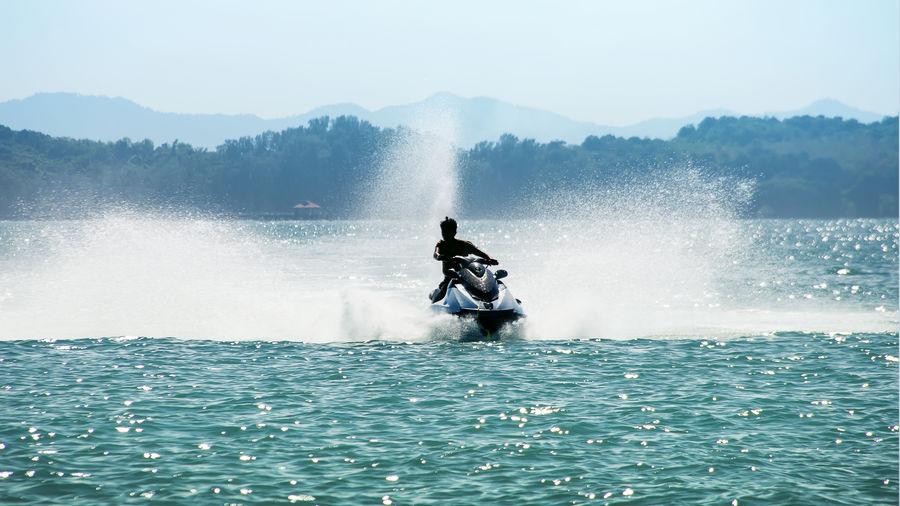 Man riding horse in sea