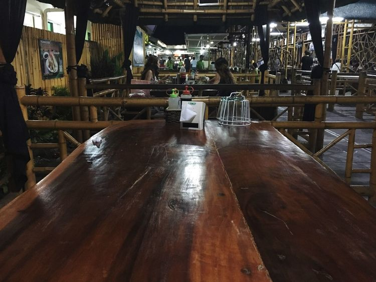 Wooden table in a diner. Indoors  Wood - Material Table Eating Real People Day