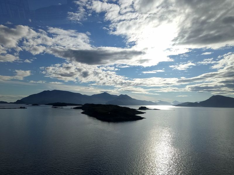 Beautiful Reflection from Sun and Clouds in Norway Islands Norway Travel Destinations Background Photography Beautiful Reflection Clear Sky Summer Day Clear View Mountain Range Norway No People 😇😇😇 Norway Nature Sun & Clouds Tranquil Moment Wallpapper