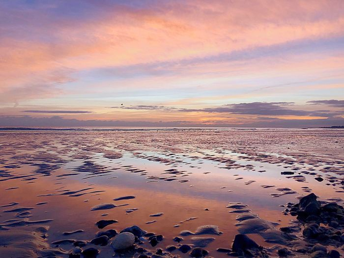 When sunset glow creates a violet sky spectacle✨ #ittlehampton #beach #lowtide #dunes #colours #mirroreffect #magic #celestial #cloudscape #evening #LCphotography Sea Water Scenics - Nature Sunset Sky Beauty In Nature Land Orange Color First Eyeem Photo