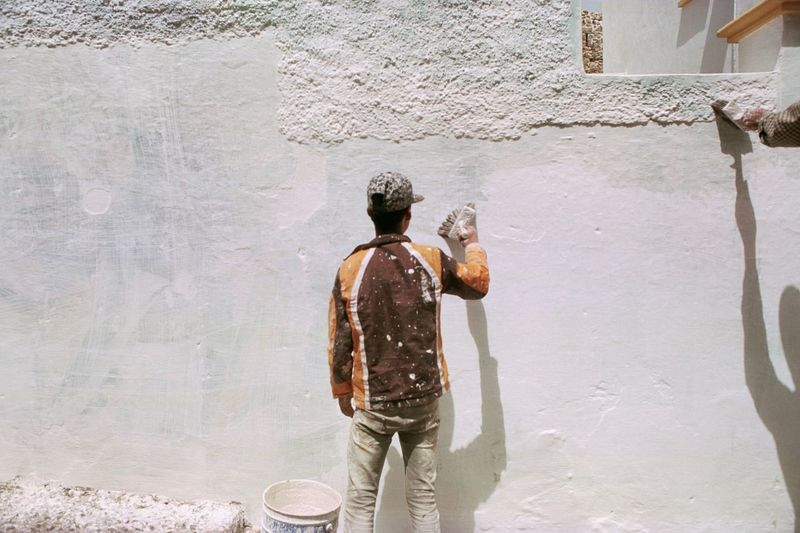 Filmisnotdead Analogue Photography Wall Painting Painting EyeEm Selects One Person Real People Rear View Wall - Building Feature Casual Clothing Lifestyles Day Men Sunlight Standing Building Exterior