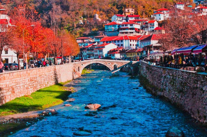 Sky Autumn Change Architecture Bridge - Man Made Structure Tree Leaf Built Structure Outdoors Nature Connection Day River Multi Colored Building Exterior Travel Destinations Water No People Scenics Beauty In Nature Footbridge