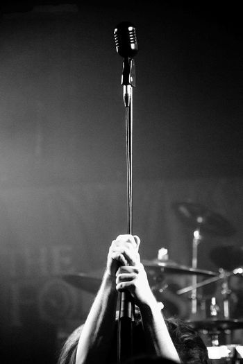 Low angle view of man holding microphone