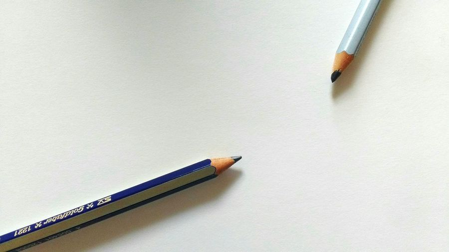Cropped Image Of Pencils Against White Background