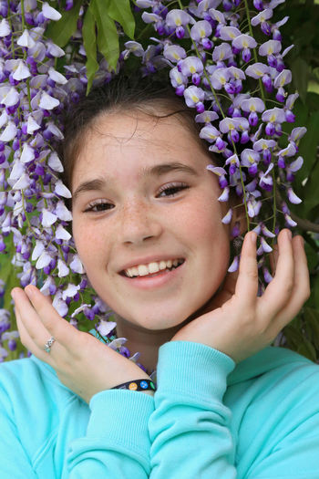 Beautiful Beauty In Nature Blue Cute Flower Girl Happy Happy People Headshot Outdoors Plant Portrait Girl Power Smile Smiling Wisteria Wisteria Flower Uniqueness