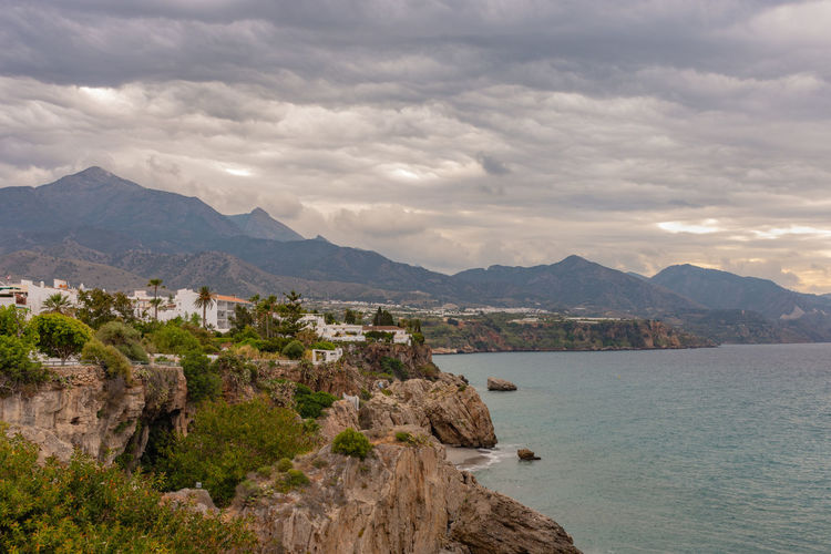 Scenic view of the Nerja coast Sea Water Sky Land Beauty In Nature Scenics - Nature Cloud - Sky Tranquility Tranquil Scene Nature No People Andalusia Andalucía Mediterranean Sea SPAIN Sunset Sunrise Clouds And Sky Cloudscape Tourism Summer Spring Autumn Travel Destinations Destination Season  Vacations Mountain Architecture Mountain Range Built Structure Day Outdoors Building Exterior City Bay Tourist Rocks Storm Cloud Costa Del Sol Balcon De Europa Nerja Trip Holiday