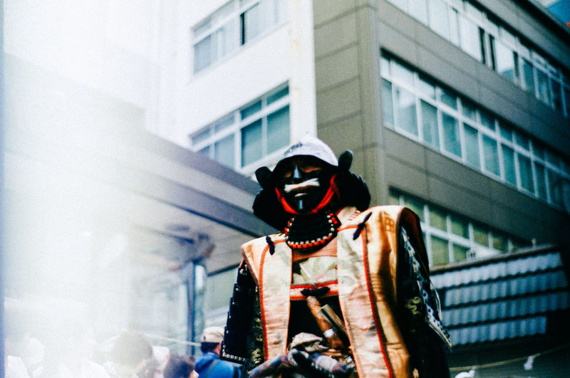 Low angle view of traditional mask in city