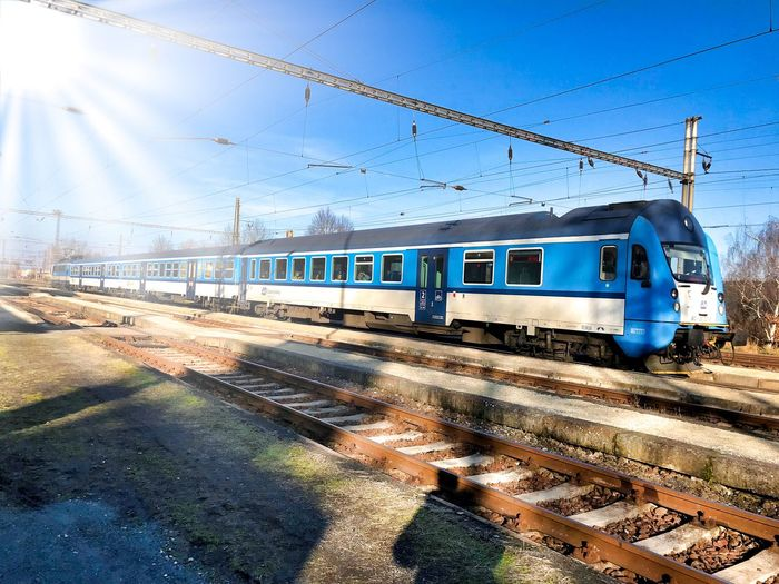Train Transportation Rail Transportation Train - Vehicle Cable Public Transportation Railroad Track Mode Of Transport Sky Day Power Line  Travel Blue No People Outdoors Sunlight Clear Sky Nature
