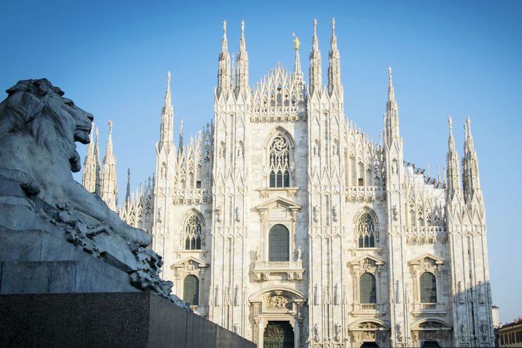 Duomo di milano against clear blue sky in city
