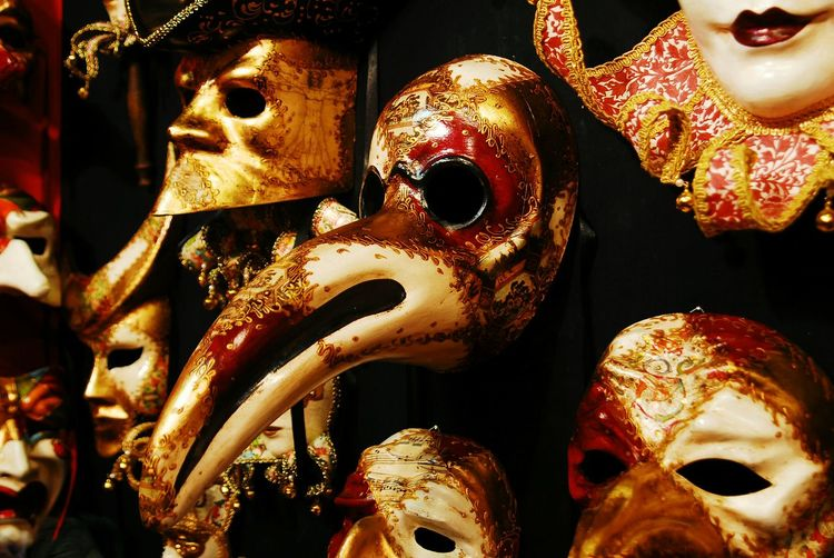 Close-up of venice carnival masks hanging on wall