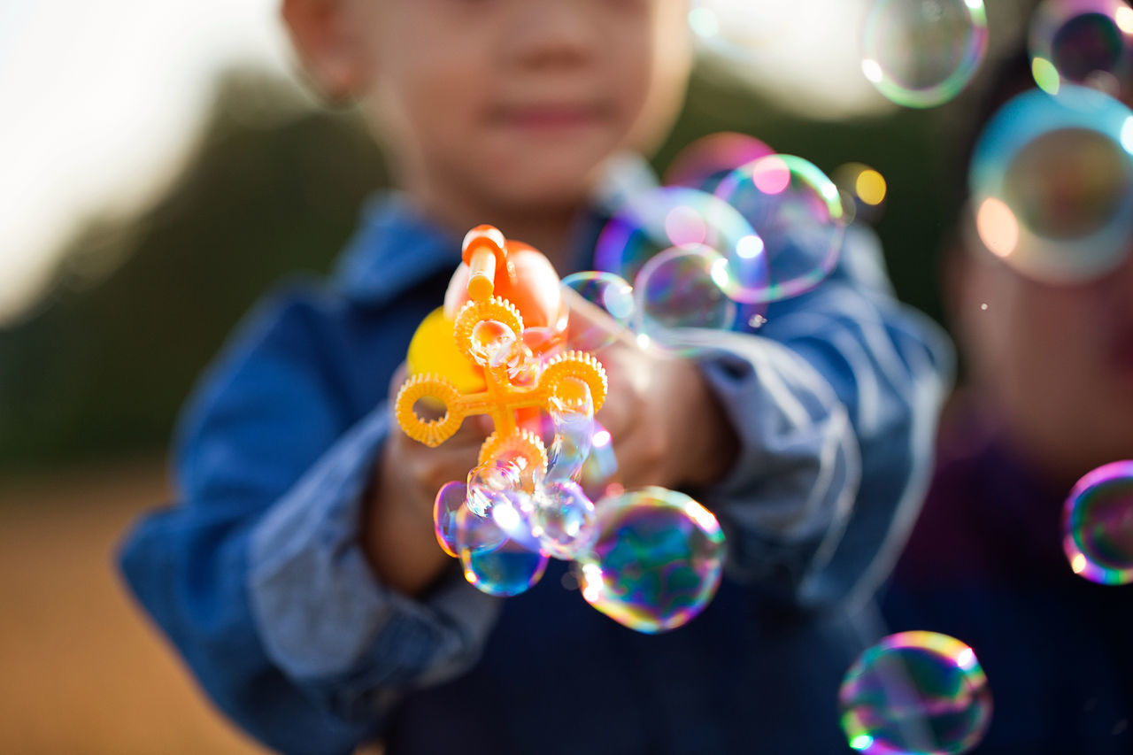 Boy playing with bubble wand