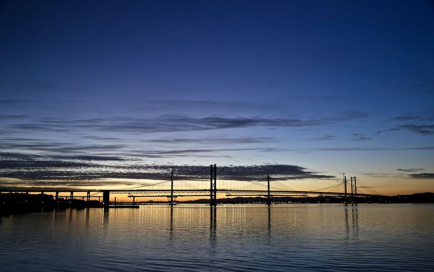 Suspension and Cable Stay(under construction) on Firth of Forth. Beauty In Nature Cloud Dramatic Sky Engineering Reflection Silhouette Sky Sunset Water Waterfront