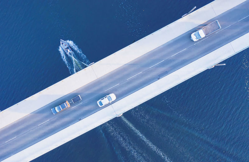 High Angle View Of Cars Moving On Bridge Over Sea