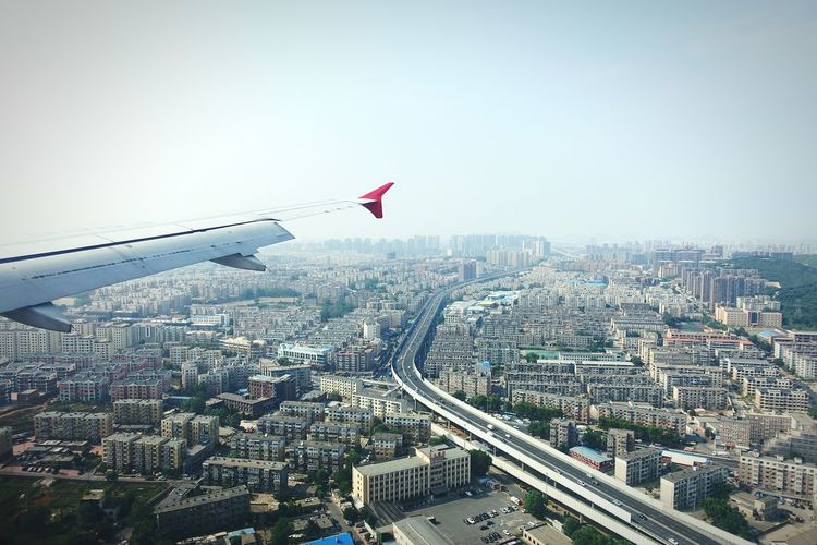 China Photos Landscape Cityscapes Approach Dalian Airport Fresh Scent Light And Shadow Streamzoofamily From An Airplane Window