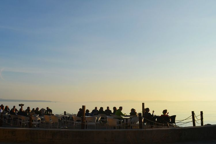 Large Group Of People Sunset Outdoors People Sky Adults Only Adult Day Tranquility Relaxed Coffeetime Drinks And Friends