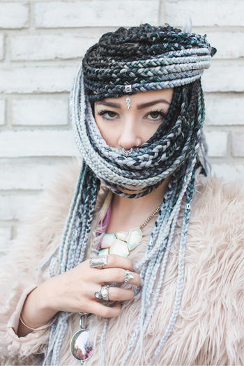Woman with very long braids wrapped around her face as a hijab Adult Beautiful Woman Clothing Cold Temperature Day Front View Fur Headshot Hipster Jewelry Lifestyles One Person Portrait Scarf Warm Clothing Winter Women Young Adult Young Women