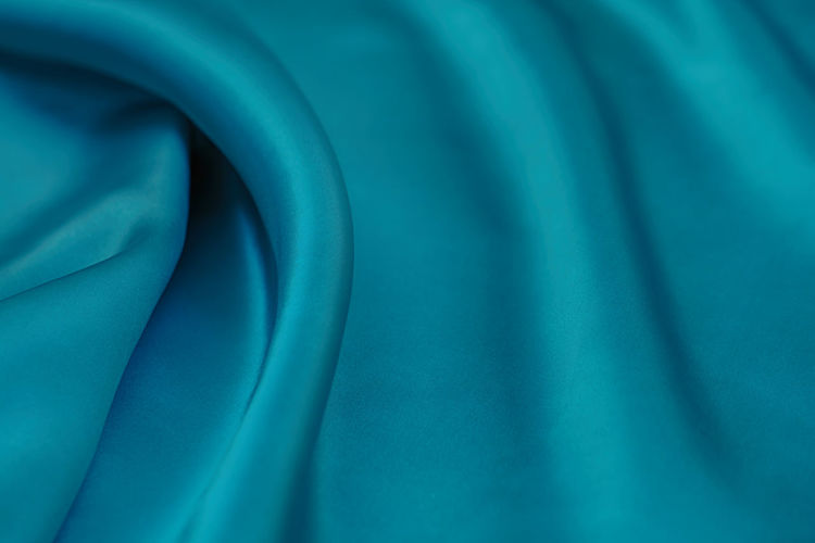 Blue Backgrounds Full Frame Textile Close-up No People Pattern Abstract Textured  Softness Indoors  Silk Rippled Turquoise Colored Curve Material Satin Wave Pattern Studio Shot Extreme Close-up Luxury Abstract Backgrounds Blue Background
