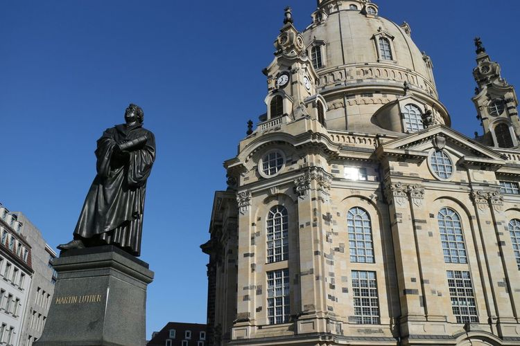 Statue Of Martin Luther In Front Of Church Against Clear Sky