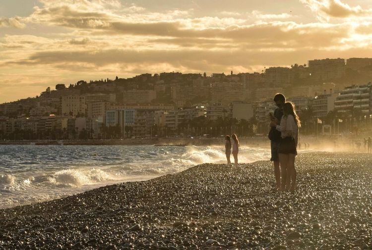 Beach Shore Wave Water Building Exterior Architecture Sea Built Structure Sunset Cloud - Sky Sky City Full Length Summer Vacations Tide Outdoors Nature City Life Scenics People Nice France Frenchriviera Côte D'Azur