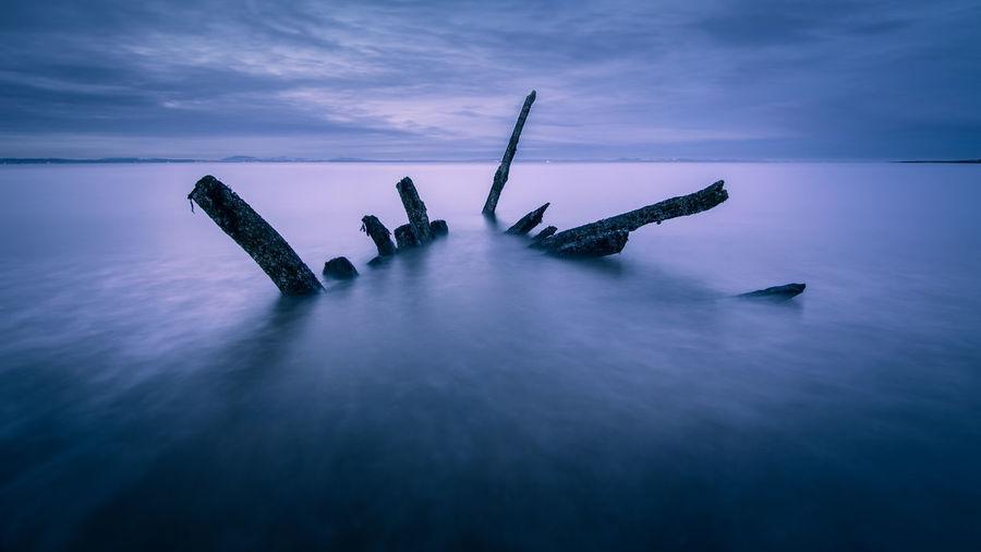 Shipwreck In Sea At Night