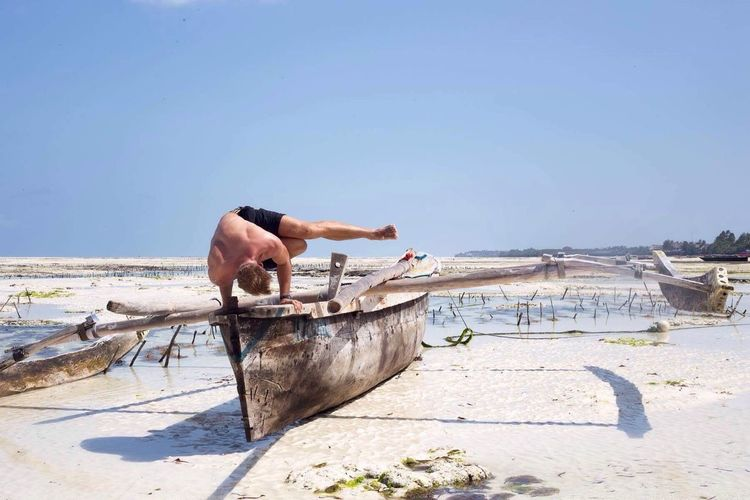 Men Yoga Yoga Pose Clear Sky Beach Sea Sun Traveling Travel Tranquility Fun Zanzibar Tanzania Africa Outdoors