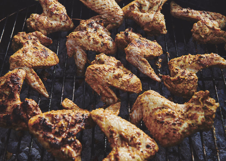 Full frame shot of chicken wings on barbecue