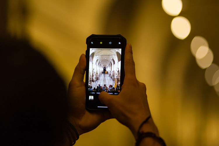 Taking pictures with a smartphone inside a museum Photography Themes Photographing Technology Mobile Phone Smart Phone Human Hand Activity Hand Holding Connection Device Screen Using Phone Real People Digital Camera Museum Photography Smartphonephotography Smartphone Photos