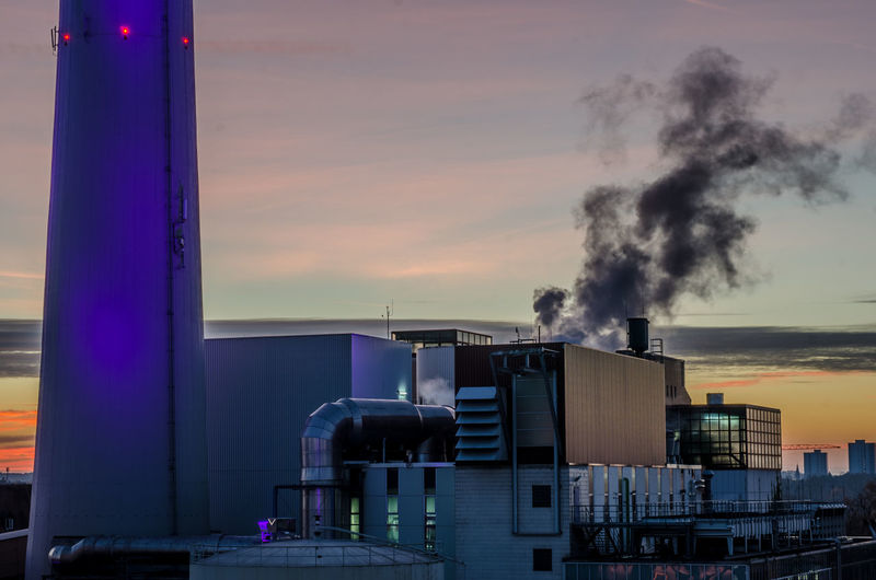 Factory Industry City Smoke Stack Smoke - Physical Structure Purple Pollution Sky Architecture Built Structure Cooling Tower Air Pollution Chimney Smoke Global Warming Environmental Damage Fumes Petrochemical Plant