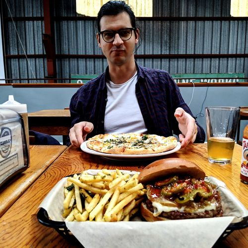 Post flight food and drinks with a teammate. Portrait Plate Table Sitting Sunglasses Food And Drink