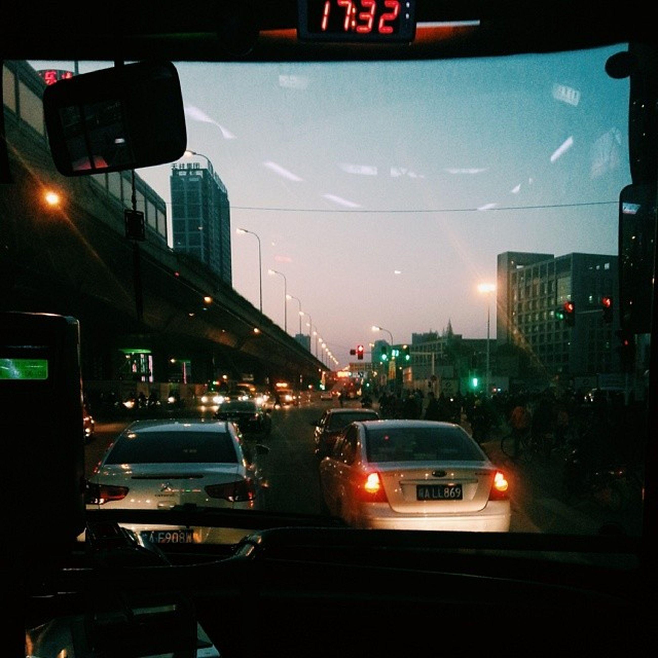 transportation, illuminated, car, land vehicle, mode of transport, building exterior, city, architecture, night, built structure, traffic, street, sky, city street, city life, street light, on the move, road, public transportation, travel