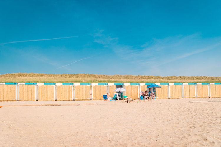 View of beach against blue sky, bergen aan zee netherlands