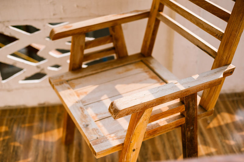 wooden chair Absence Architecture Art And Craft Brown Built Structure Chair Close-up Creativity Day Easel Focus On Foreground Furniture High Angle View Indoors  No People Seat Still Life Table Wood Wood - Material