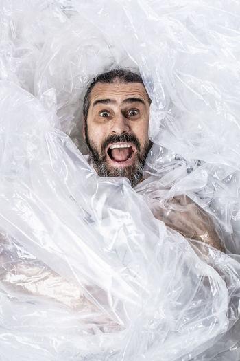 Portrait of man holding plastic screaming