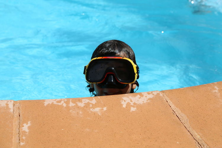 Close-Up Of Boy Swimming In Pool