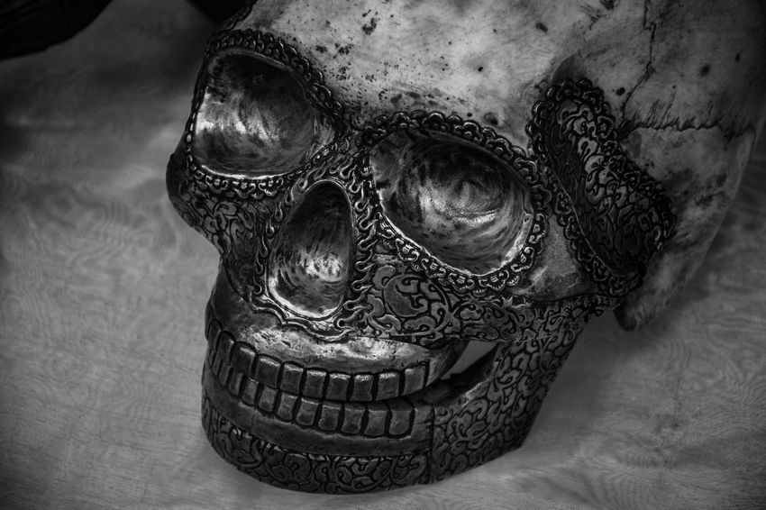 With the new day comes new strength and new thoughts. EyeEm Selects EyeEmNewHere The Great Outdoors - 2018 EyeEm Awards The Week on EyeEm Art And Craft Blackandwhite Bw_collection Bw_lover Close-up Craft Creativity Design Disguise Eye4photography  Focus On Foreground Indoors  Mask - Disguise No People Ornate Representation Sculpture Single Object Skull Skulls Statue