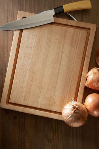 High angle view of person hand on cutting board