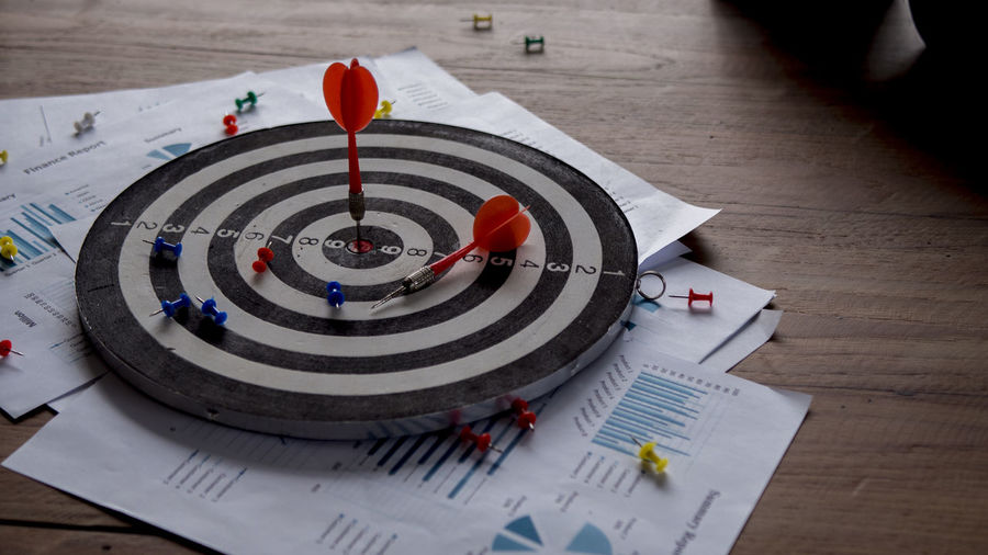 Setting goals for business success and commercial concepts Sport Table Paper Accuracy Circle Sports Target Geometric Shape Close-up Indoors  Shape No People Focus On Foreground Skill  Red Design Target Shooting Still Life Arrow - Bow And Arrow Planning Pattern