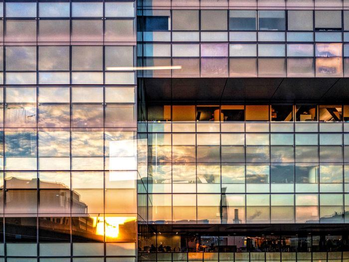 The Street Photographer - 2017 EyeEm Awards Architecture Building Exterior Built Structure Window Modern Reflection City Sunset No People Sky Cloud - Sky Skyscraper Outdoors Day