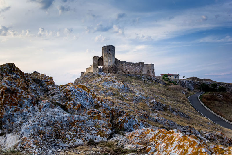 Castle Ancient Ancient Civilization Architecture Beauty In Nature Built Structure Citadel Cloud - Sky Day Europe Fortress Historic History Landmark Medieval Mountain Nature Old Ruin Outdoors Rock - Object Sky Stone Stronghold Tourism Travel Destinations
