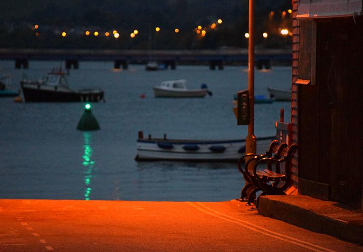 Illuminated boat at sea during sunset