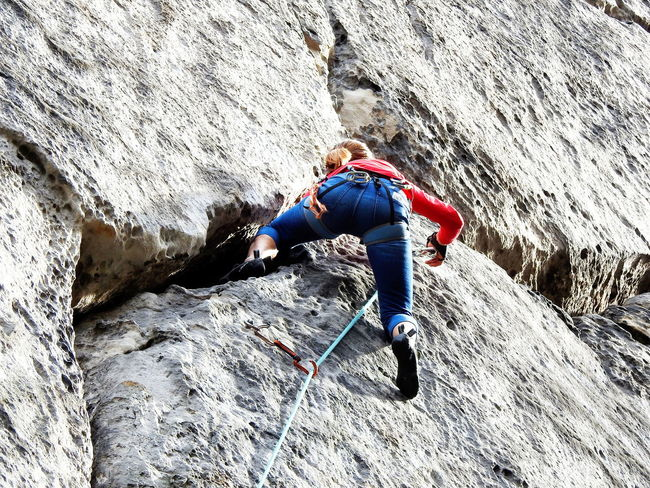 Adult Adults Only Adventure Challenge Climbing Day Extreme Sports Full Length Low Angle View Motion Mountain Mountaineering Landscape One Man Only One Person Only Men Outdoors People Real People Rock - Object Rock Climbing Rock Face Sports Clothing