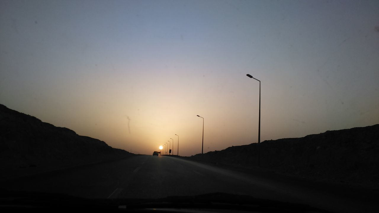 car, transportation, sunset, sun, land vehicle, mode of transport, road, no people, silhouette, sky, nature, mountain, beauty in nature, car point of view, scenics, road trip, outdoors, day