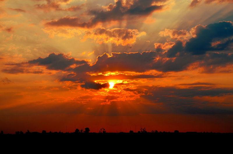 Beauty In Nature Cloud Cloud - Sky Cloudy Horizon Over Land Landscape Moody Sky Nature Orange Color Outdoors Sky Sun Sunbeam Sunlight Sunset