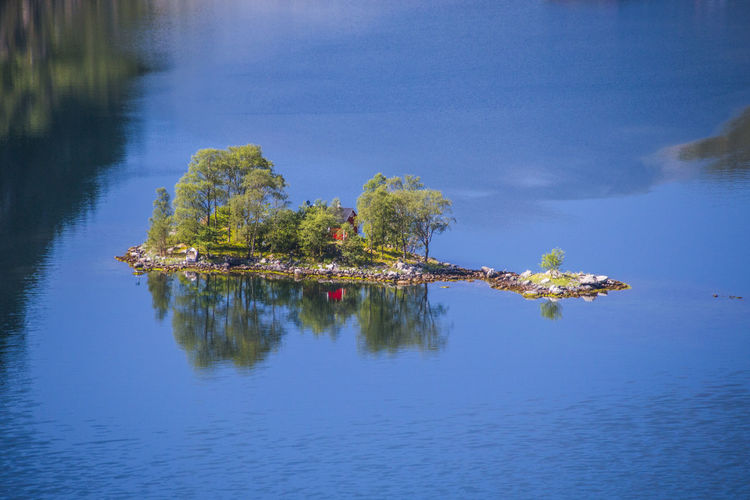High angle view in Island with cabin Beauty In Nature Blue Cabin Cabin On Island Day Idyllic Island Lake Land Nature No People Non-urban Scene Outdoors Plant Reflection Scenics - Nature Tranquil Scene Tranquility Tree Water Waterfront