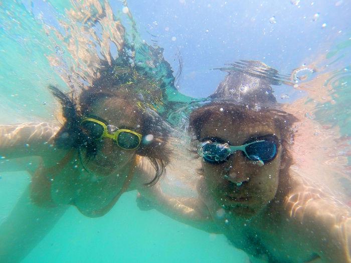 Couple swimming in sea