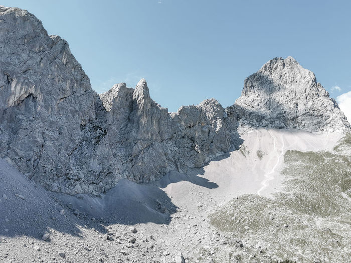 Scenic view of lamsenspitze and other rocks against clear sky, karwendel, tyrol