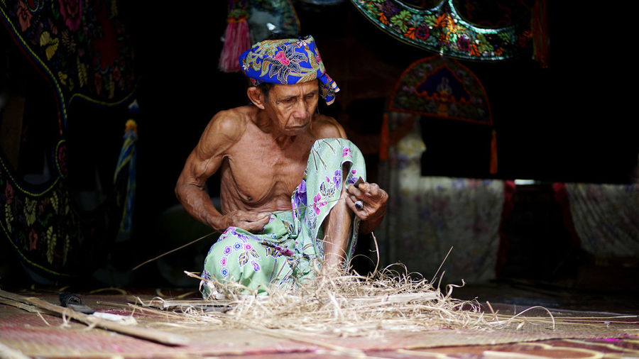 Man working in traditional clothing