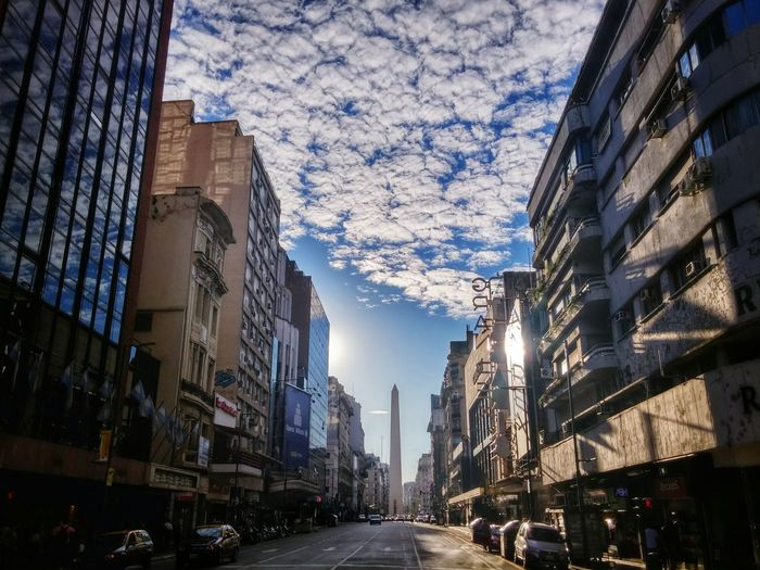 Avenida Corrientes. City Architecture Building Exterior Day Sky Outdoors Cloud - Sky No People Built Structure Architecture Sun Light Sunny Sunshine Obelisk Avenue Obelisco Dramatic Sky Sunlight Obelisco, Buenos Aires 🌆 The City Light The Street Photographer - 2017 EyeEm Awards The Architect - 2017 EyeEm Awards