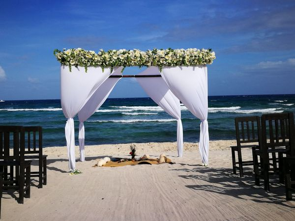 Gazebo On The Beach Gazebo And Nature Floral Arrangment Wedding Decoration Weddingday  Weddingday  Beauty In Nature Beach Wedding No People Flower Sand Water Summer Horizon Over Water Sea Outdoors Nature Mexican Wedding Wedding Riviera Maya Day Wave Multi Colored Beach Caribbean